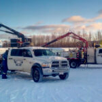 Dark Arc Welding trucks and personnel on the job site