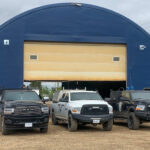 Outside view of the shop and our trucks